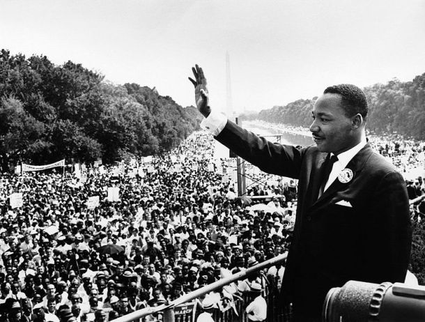 """Martin Luther King, Jr. waving to crowd at the Washington Monument during his """"I Have a Dream"""" Speech. (Wikimedia Commons)"""